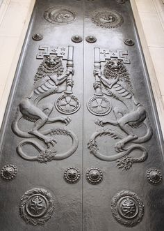 Bronze Door: Bank of England - Prince's Street    The doors on The Bank of England Building are very beautiful, and this is the largest and most dramatic The splendid bronze doors were by sculptur Sir Charles Thomas Wheeler and were cast by the Morris Singer Foundry between 1925 - 35.