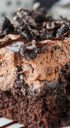 "Oreo Dirt Poke Cake ~ The chocolate cake is soaked in hot fudge and covered with a Chocolate Oreo Mousse also known as ""dirt""."