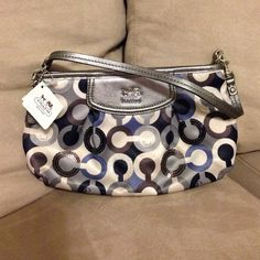 Blue and silver coach wristlet Blue and silver coach wristlet with sequins.... Never used still has tag! Coach Bags Clutches & Wristlets