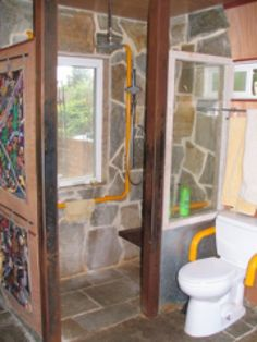 The 15 square-foot walk-in shower includes two showerheads, a seat, and rough gold mica for the floor and walls.  Fourteen linear feet of grab bars creates a safe shower stall for me. There is no shower entry lip, so there is complete and safe accessibility.