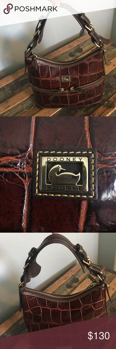 Listing Dooney & Bourke Hobo Bag Beautiful, in really nice condition, leather Croco Embossed North/South Zip Sac Hobo, dark brown, shoulder bag, one owner, only used a few times. Dimensions & details in last photo. Note:few small pen marks & slightly dented/scratch on bottom()see photos) Dooney & Bourke Bags Shoulder Bags