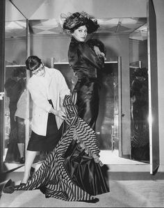 Edith Head tailors a dress for Sophia Loren. Head was well known for her ability to work with difficult personalities and to camouflage figure problems.