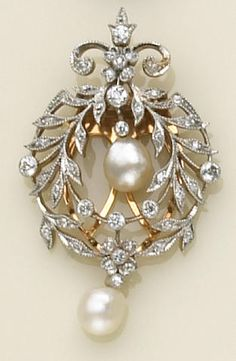 A diamond, pearl and platinum-topped gold clip-brooch.