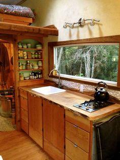 Yoga teacher's hand-built tiny house is a warm woodland haven