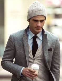 Men's Beige Beanie, Grey Blazer, Black Tie, Beige Cardigan, Chocolate Pocket Square, and White and Blue Vertical Striped Dress Shirt