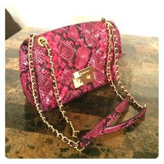 "large shoulder bag w/ embossed leather in fuchsia Michael Kors designed larger shoulder bag with extended gold chain detail and gold class lock with slip back pocket. Worn a few times for photoshoot. Dimensions: 10-1/2"" W x 7"" H x 3-1/2"" D MICHAEL Michael Kors Bags Shoulder Bags"