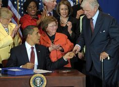 President Obama hands a pen used to sign the Edward M. Kennedy Serve America Act to Sen. Edward Kennedy, D-MA, at the SEED Public Charter School on April 21, 2009