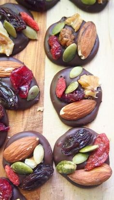 2 Ingredient Organic Dark Chocolate Trail Mix Energy Bites; gorgeous idea; dollop of chocolate, drop on any whole food toppings and let cool.