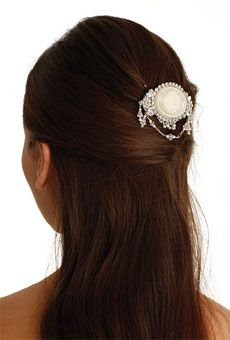 This Lalique-inspired cameo brooch epitomizes the era's whimsical jewelry designs.    Style A456, $225, Erica Koesler