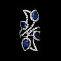 PEAR SHAPE SAPPHIRE AND DIAMOND RING