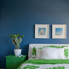 kelly green and navy bedroom designed by Emily Henderson