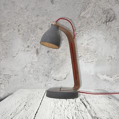 E2 Contract Lighting | Products | Concrete Desk Lamp CL-32480 and CL-32481 | Contemporary Concrete desk lamp in wood with running red cable, comes in two.