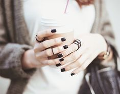 Saucy hands = black nails and many rings
