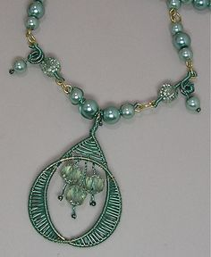 Seafoam Wire Pendant Close-up by auntgriz, via Flickr