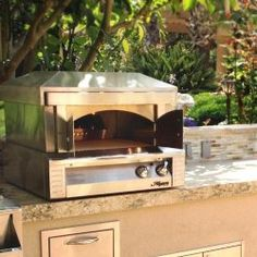 Very cool portable gas pizza oven. Cook a pizza in a few minutes