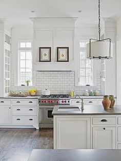 Love all the windows instead of cupboards above the counters, as well as the built-ins on the side.