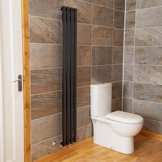 Nevada Beta Heat 1600 x 240 Single Panel Anthracite Colosseum Radiator. A stunning designer colosseum radiator that adds warmth and style to any bathroom. With an output of 1781 BTUs and tested to a high quality standard. Bathroom Heat Lamp, Bathroom Heater, Bathroom Radiators, Bathroom Wall, Bathroom Ideas, Shower Ideas, Bathroom Sealants, Black Radiators, Vertical Radiators