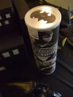 Cute idea with the batman emblem light. Inspiration for a DIY party favor? - could have multiple lids per can to do a spider web, bat signal, 4, X, S from Superman's chest, etc.