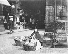 Flower woman, Ludgate Hill Station, by Paul Martin. Museum quality art prints with a selection of frame and size options, and canvases. Museum of London Victorian Street, Victorian Life, Victorian London, Vintage London, Old London, London Pictures, Old Pictures, Old Photos, London History