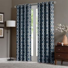 """Update your room with a stylish and modern Ogee window panel. The subtle blue color adds a refreshing touch to the print, while the chenille jacquard fabric creates a beautiful texture. Microfiber lining offers room darkening features and energy saving abilities. Grommet top detail makes it easier to hang, open, and close panels throughout the day. Fits up to 1.25"""" diameter rod."""