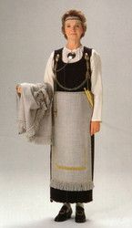 """""""The model of the ancient costume of Tuukkala is based on the archaelogical findings. As a crudsade style, there are a gorgeus jewerly made of bronze. The tail of the skirt and the woollen apron are also decorated with bronze spirals. The woollen cloak includes in the costume."""""""
