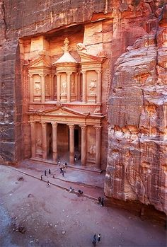 NABATAEAN.  Al Khazneh (the Treasury) at Petra in Jordan, 1st century CE.  //  Despite its title, the iconic Al Khazneh was built as a mausoleum.  The origin of the name is a legend claiming that an urn on the second story is full of gold.  Though untrue (the urn is solid stone), the urn is pockmarked with bullet holes created by treasure hunters hoping to break it open.