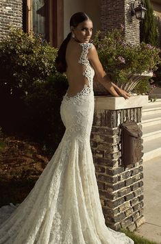 Galia Lahav Wedding Dress Collection 2014: The Empress Collection - Madonna Slim fitting lace wedding dress featuring a low, bare back and intricate, corded lace applique detail around the edges.