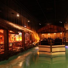 It's a total fantasy inside the Fairmont Hotel, and, inside the Tonga Room & Hurricane Bar, tables surround a lagoon where the band floats on a ship-shaped stage.