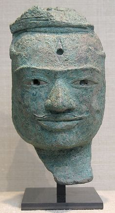 Face from a male Deity, probably Lord Shiva. Angkor period ca. 930–60 Cambodia. Bronze with silver inlay. Few large bronze sculptures from 10th C. Cambodia survived.