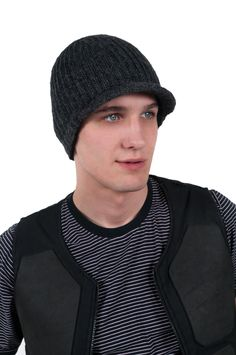 Ribbed Visor Hat with fleece  $35  A basic hat for any head with just a touch of style in the form of a brim. Wool with fleece lining.
