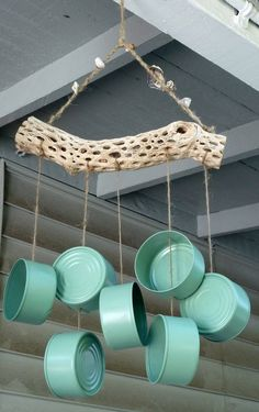 Spray-painted tuna cans wind chime