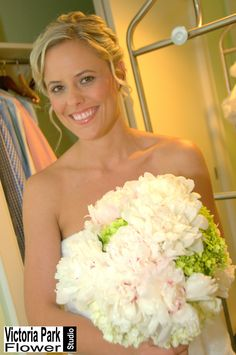 Bridal Bouquet arranged with Blush Peonies and White and Green Hydrangea