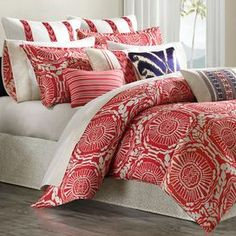 "Cotton comforter set with a medallion motif.   Product: Twin: 1 Comforter, 1 standard sham and 1 bed skirtFull: 1 Comforter, 2 standard shams and 1 bed skirtQueen: 1 Comforter, 2 standard shams and 1 bed skirtKing: 1 Comforter, 2 king shams and 1 bed skirtCalifornia King: 1 Comforter, 2 king shams and 1 bed skirtConstruction Material: 100% Cotton and polyester fillColor: Coral redFeatures:  15"" Bed skirt dropPolyester-filled comforter180 Thread count Dimensions: Standard Sham: 20"" x 26""…"