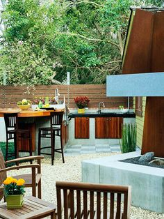 Off the Shelf - Dress up unpretentious concrete and pavers to make a design statement in your outdoor kitchen. Simple materials, such as the plain concrete block that forms the foundation for this kitchen, can appear grand when used with a keen eye for design.