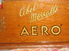 the Abel Morrall's AERO inscription on the Deco needle stand. (next)