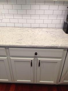 Thornapple kitchen: before and after. Romano Blanco granite, white subway tile backsplash, gray owl cabinets.