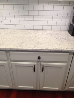 Thornapple kitchen: before and after. Romano Blanco granite, white subway tile backsplash, gray owl cabinets.