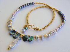 Peacock Keshi Pearl Gold Vermeil Necklace by Moonsnail:  https://www.etsy.com/ca/listing/87361528/silver-biwa-pearl-necklace-silver-white?ref=shop_home_active_14