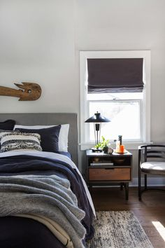 Relaxing and beautiful bedroom. Denim blue, natural colors, knitted blanket.