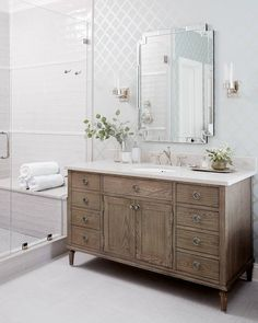 Loving the warmth and touch of character a wooden vanity brings to this light + bright bathroom! Design by @southernstudio. Photo by @staceyvanberkelphoto.  Tile featured: Retro Perla + @annieselke Crosshatch White. Bathroom Tile Designs, Bathroom Renos, White Bathroom, Bathroom Interior, Bathrooms, Wooden Vanity, The Tile Shop, Beautiful Mirrors, Light And Space