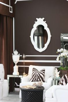 love the rich chocolate walls with white furniture and accents, really brings depth into the room