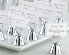 Silver kissing bell table holders, so cute!