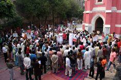 Muslims and Christians gather outside Lahore church. PHOTO: SHAFIQ MALIK