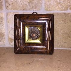 Carved Square with Ammonite Shell in Center