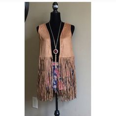 Faux Suede Fringe Vest You will love this faux suede fringe vest by Paper Crane. Looks cute with shorts, jeans, over over a dress.  ❤️ Paper Crane Tops