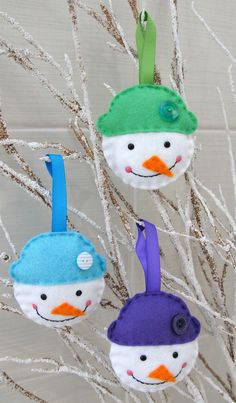 Wool mix Felt Snowman Decorations. All hand cut and hand sewn using quality wool mix felt these Snowmen are 8cm tall by 8cm wide. Wearing