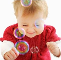 Babies and bubbles make cute photographs together.