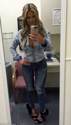 'I turn my feet in so you can see my damn shoes not to have a thigh gap cause I have that anyway!' Kim Zolciak-Biermann boasted about her body Wednesday while visiting Emory University Hospital in Atlanta