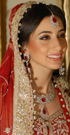Sahar wears classic red and gold Makeup by the talented Leena Ghani