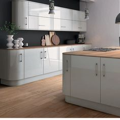 High gloss kitchen Doors are visually stunning, hard-wearing and epitomise a modern home. With lighter colours in particular, gloss reflects natural light and creates a sense of space. Combine this with a simple slab or handleless door and the effect is accentuated. If you have a small kitchen or it has little natural light, this on-trend look could be the very thing. Check out Zurfiz in Ultragloss Light Grey. Clever choice of decor, worktop and flooring gives a modern, but homely feel. High Gloss Kitchen Cabinets, Kitchen Cabinet Doors, Replacement Kitchen Doors, Light Grey Kitchens, House Extensions, Natural Light, Lighter, Clever, Colours